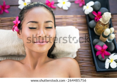 Serene woman with closed eyes enjoying in spa treatment - stock photo