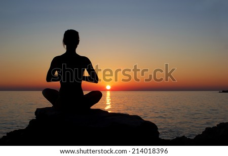 serenity and yoga practicing at sunset, meditation - stock photo