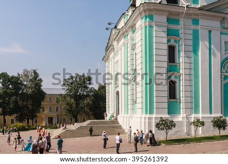 SERGIEV POSAD, RUSSIA - AUGUST 09, 2015: Tourists and parishioners around the bell tower. Holy Trinity-St. Sergiev Posad. Moscow region