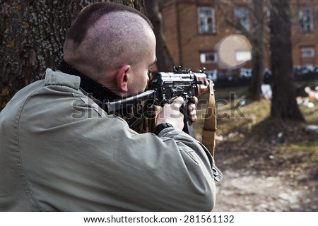 Serial killer concentrated to open the fire - stock photo