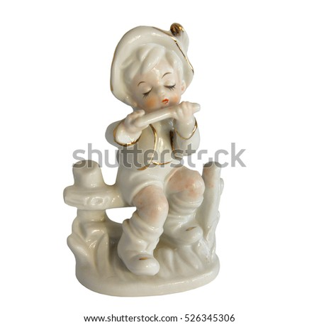 serial porcelain figurine of a boy playing a flute from the decor store isolated on white - The Decor Store