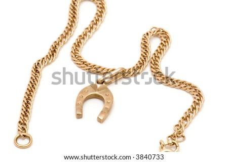 series object on white - Gold chain with horseshoe