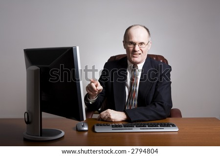 Series of an older businessman at desk.