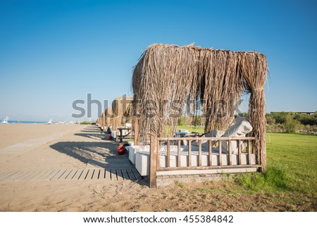 Series of bungalows on the sandy sea shore - stock photo