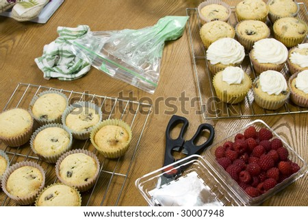 Series of images depicting the mixing of ingredients, baking, and final decorating of cupcakes. - stock photo