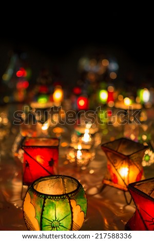 Series of lamps with beautiful colored lights standing on the Jemaa el Fna square in Marrakesh at night. - stock photo