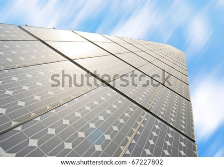 series of solar energy panels under blue sky - stock photo