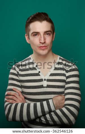 Series of studio lifestyle shots of a casual fresh caucasian man in a stylish casual outfit on a teal blue background with room for copy. - stock photo