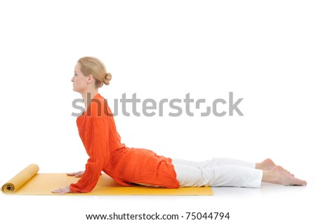 series or yoga photos. young woman in cobra pose on yellow pilates mat