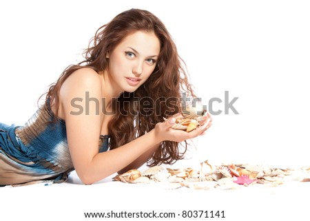 series photo of  the pretty young woman with long red curly hair lying on the floor hold sea shell in hand with marine cockleshell, isolated over white background. Concept freshness, Spa resort