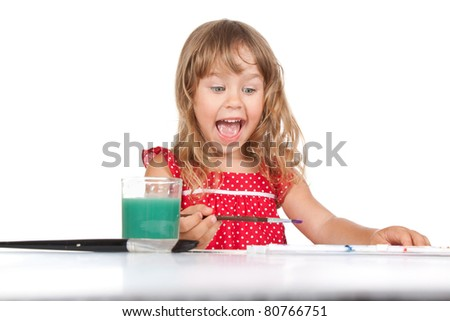 series photos of young attractive little happy smiling 4 years girl with paint sitting at the table, desk isolated over white background