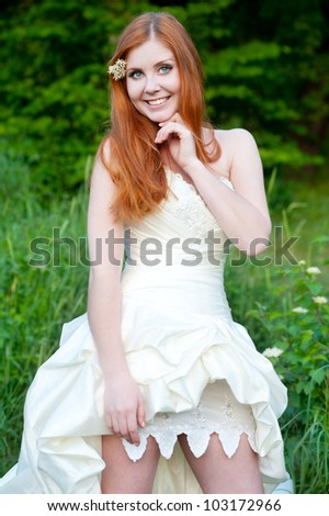 Series. Portrait of the young beautiful bride on the nature - stock photo