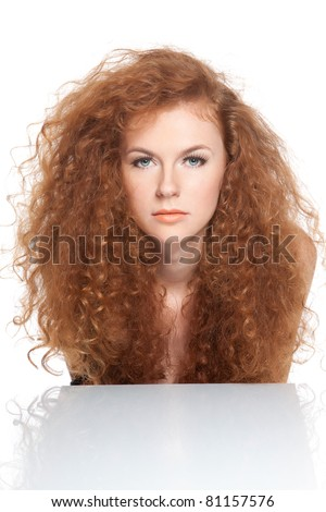 series sensual portrait of the pretty young beautiful woman with long red curly hair isolated over white background. Concept of beauty hair care, wellness, style, shampoo, in studio - stock photo