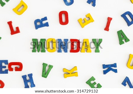"Series ""Weekday"": word Monday in wooden letters on white background"