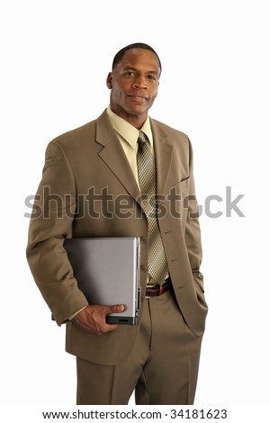 Serious African American businessman holding laptop computer on white background - stock photo