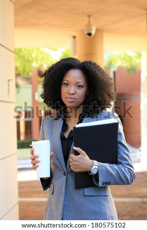 Serious African American Professional Business Person Pretty Beautiful Wearing Black Shirt and Suit - stock photo