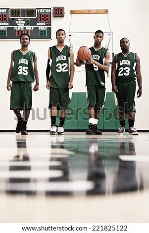 Serious African basketball players in gym - stock photo