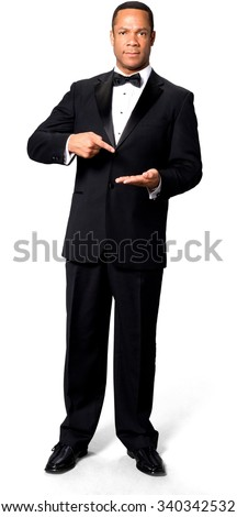Serious African man with short black hair in evening outfit holding invisible object - Isolated