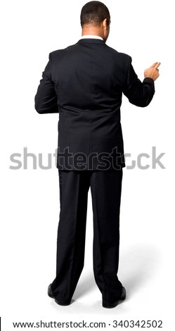 Serious African man with short black hair in evening outfit pointing using finger - Isolated