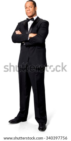Serious African man with short black hair in evening outfit with arms folded - Isolated
