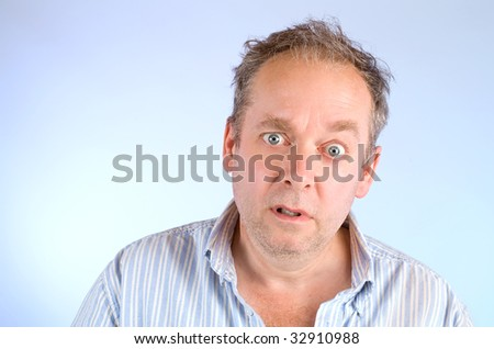 Serious and Scruffy Looking Man - stock photo