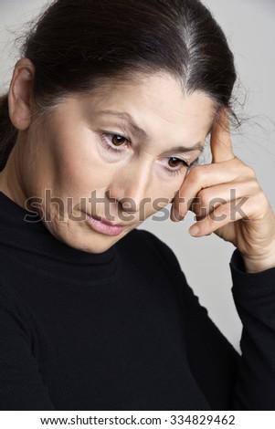 Serious asian woman - stock photo