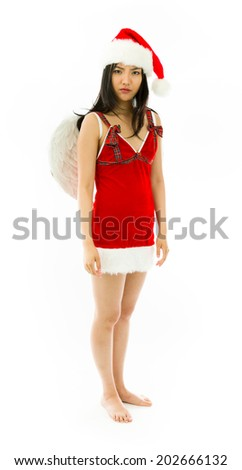 Serious Asian young woman wearing Santa costume dressed up as an angel isolated on white background - stock photo