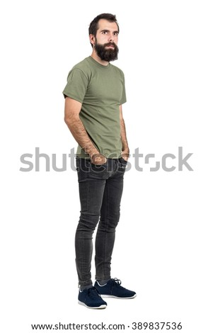 Serious bearded man with hands in pockets looking at camera. Full body length portrait isolated over white studio background. - stock photo