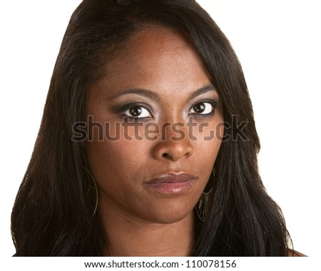 Serious Black woman with long hair on isolated background