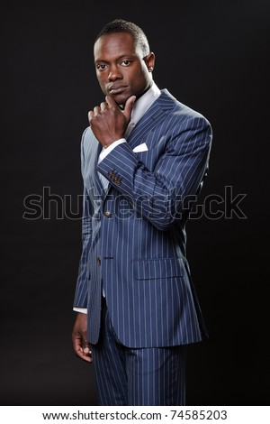 Serious black young business man in suit. - stock photo