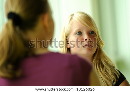 Serious blond girl in a meeting is listening. - stock photo