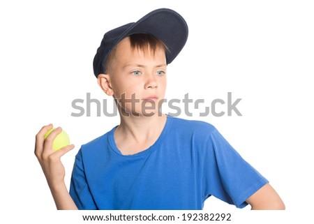 Serious boy holding a tennis ball. - stock photo