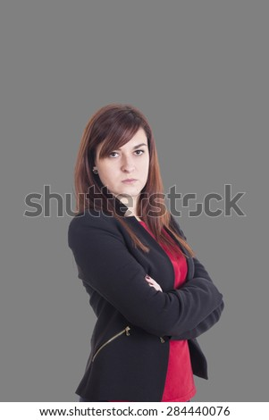 Serious business girl with cross arms - stock photo