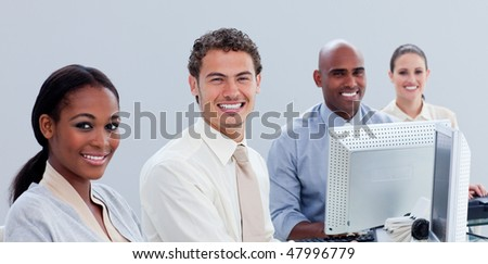 Serious business group working hard in the office in a company - stock photo