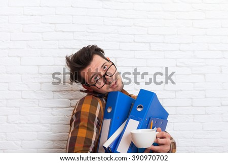 Serious Business Man Busy Holding Many Folders Coffee Cup Cell Phone Call Speak Smart Phone Concept Lot of Work Office Over White Brick Wall - stock photo