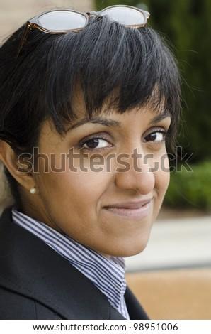 serious business woman turning toward the camera - stock photo