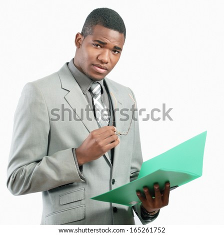 Serious businessman holding file - stock photo