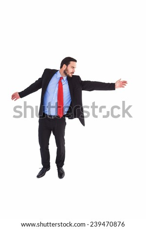 Serious businessman in suit gesturing with hand on white background - stock photo