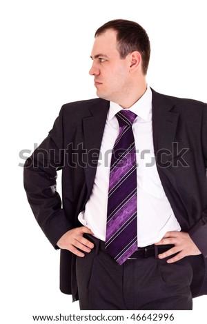 serious businessman looks somewhere, white background - stock photo