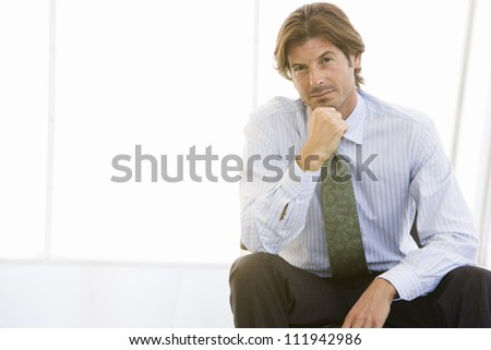 Serious businessman sitting in office