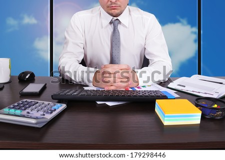serious businessman sitting in office - stock photo