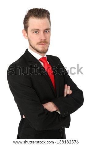 Serious businessman wearing a suit and red tie. White background.