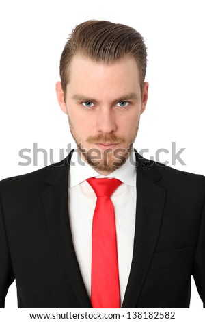 Serious businessman wearing a suit and red tie. White background. - stock photo