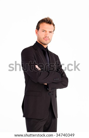 Serious businessman with crossed arms looking at the camera