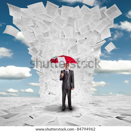 Serious businessman with red umbrella under huge wave of documents - stock photo