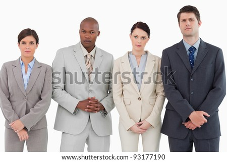 Serious businessteam standing together against a white background - stock photo
