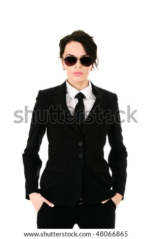Serious businesswoman in black glasses holding hands in pockets isolated on white background - stock photo