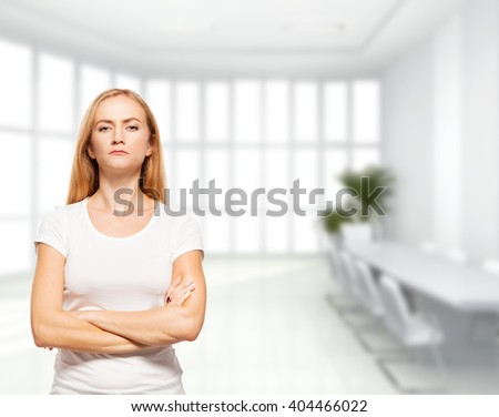 Serious businesswoman in the office. Young sad female - stock photo