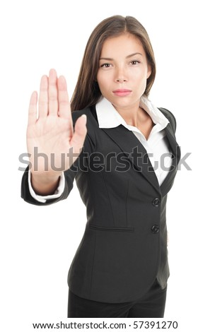 Serious businesswoman making stop sign on white background, focus on business woman. - stock photo