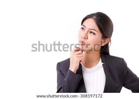 serious businesswoman thinking, looking up - stock photo